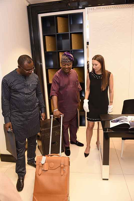 Prince Rotimi Ibinabo, Chairman Aerotech Offshore (middle) wheeling a display Artcase in Alter Ego Private Atelier